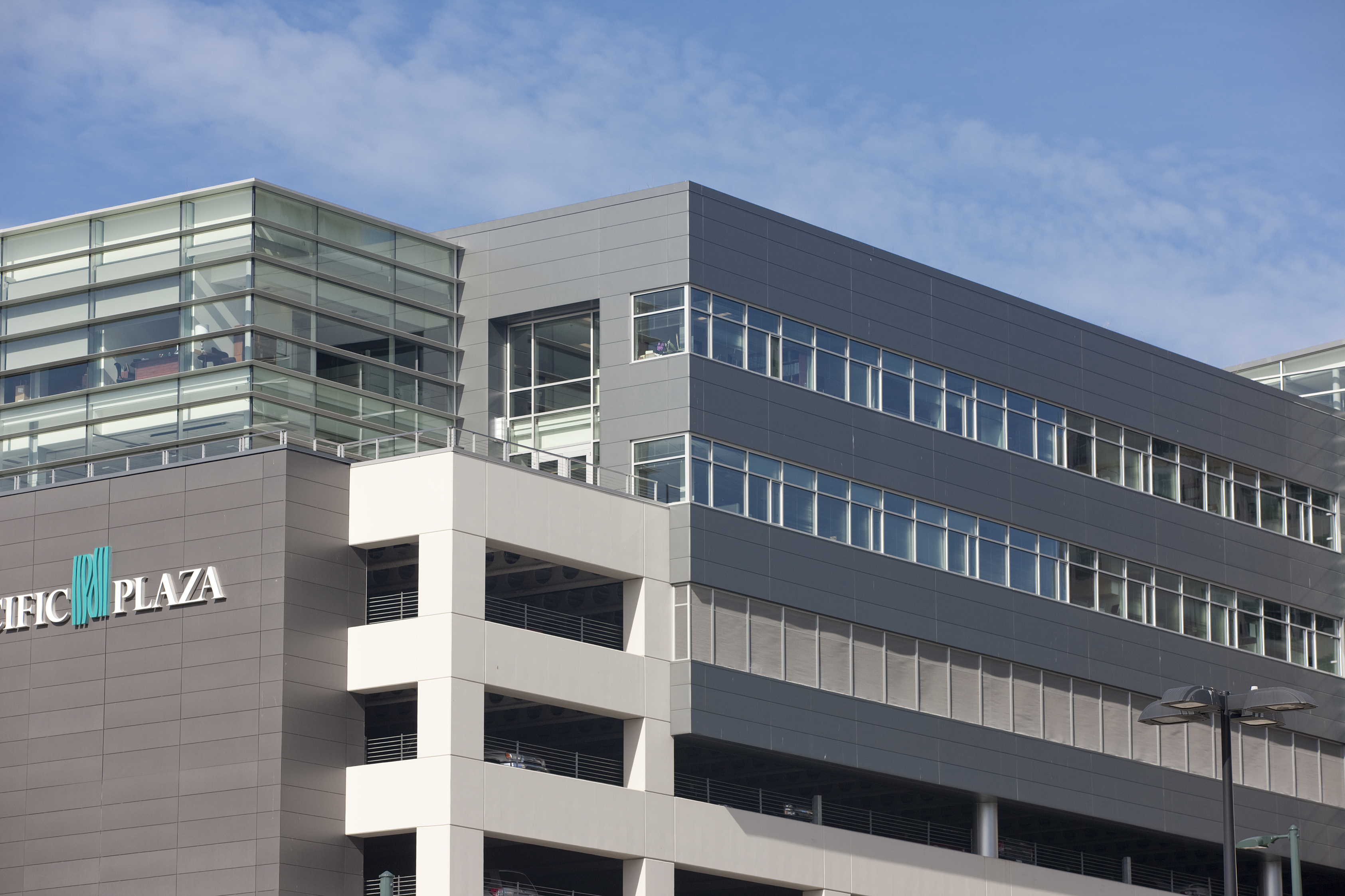 More Than 26,000 Sq. Ft. Of Metl Span CF Insulated Panels Were Used To Clad  The Inhabited Portion Of The Office Building/parking Garage Structure.
